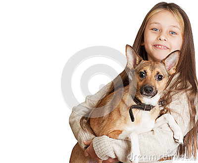Little girl with long hair holding a dog