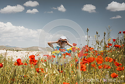 Little girl looking through binoculars outdoors Stock Photo