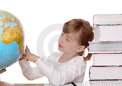 Little girl looking at globe