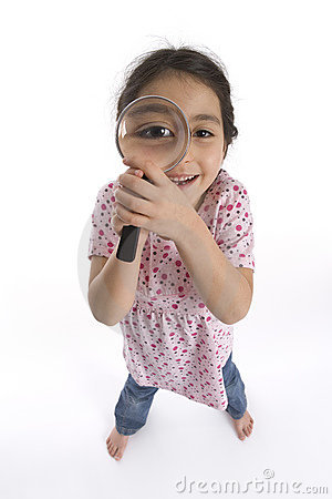 Little Girl Is Looking Through A Magnifying Glass