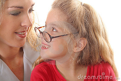 Little girl looking at mom with glasses