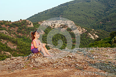 Little girl looking at the mountain