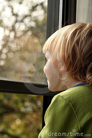 Free Little Girl Looking Out Window Royalty Free Stock Photo - 1452005