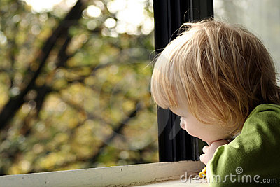 Little girl looking out window