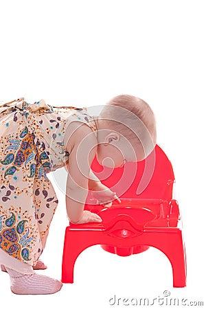 Little girl looking in potty