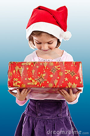 Little girl looking in present box