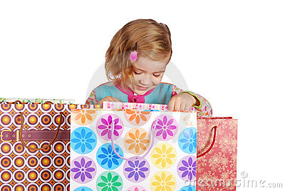 Little girl looking in shopping bags