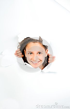 Little girl looks with sheet of torn white paper