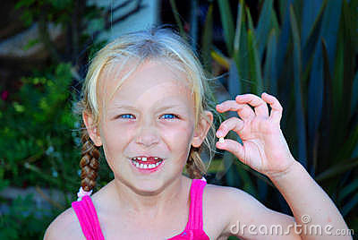 Little girl with lost baby tooth