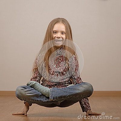 stock photography little girl in lotus position is on