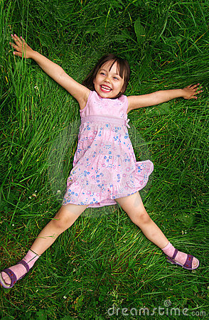 Little girl lying on grass