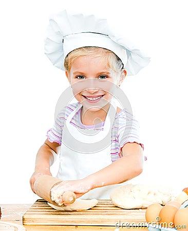 Little girl makes dough