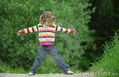 Little girl makes gymnastic in park