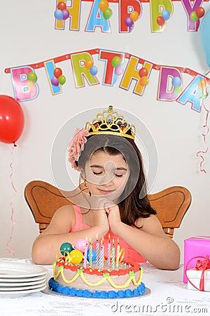 Little girl making birthday wish