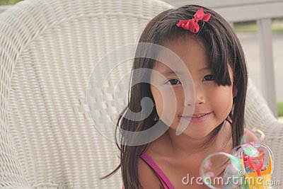 Little girl making bubbles