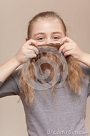Little girl making  moustache