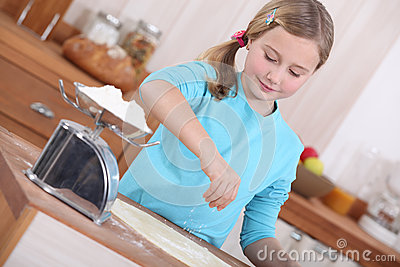 Little girl making pancakes