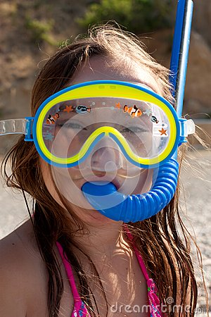 Little girl with mask and  snorkel for diving