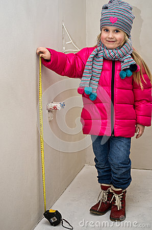Little girl with measure tape