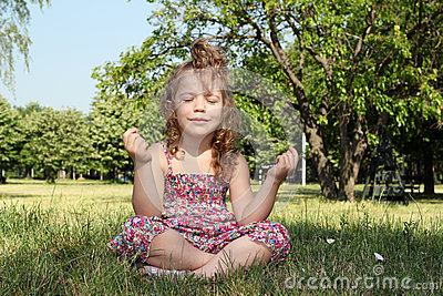 Little girl meditates