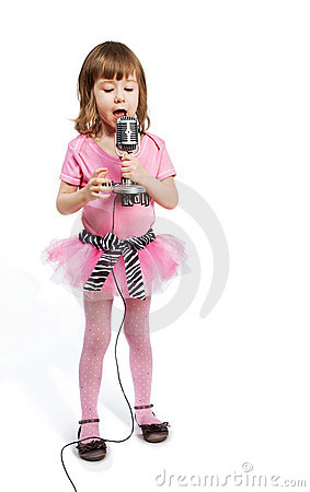 Little girl with microphone sings a song