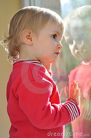 Little girl and mirror