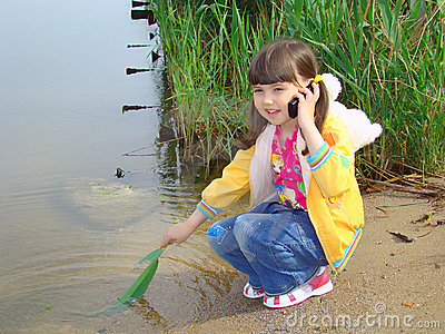 Little girl with a mobile telephone.