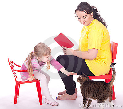 Little girl and mother with book and cat