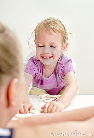 Little girl with mother playing domino