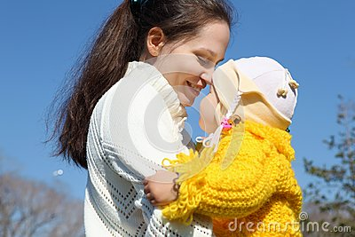 Little girl with mother in spring park