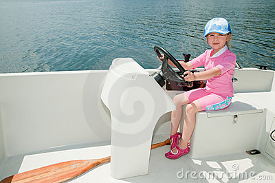 Little girl on motorboat