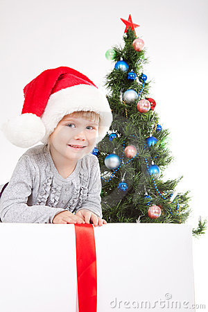 Little girl near the Christmas Tree