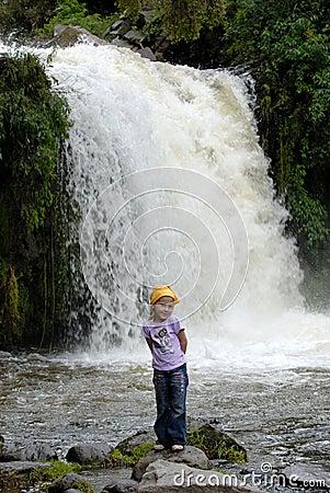 Free Little Girl Near Mountains Waterfall Stock Photos - 1746183