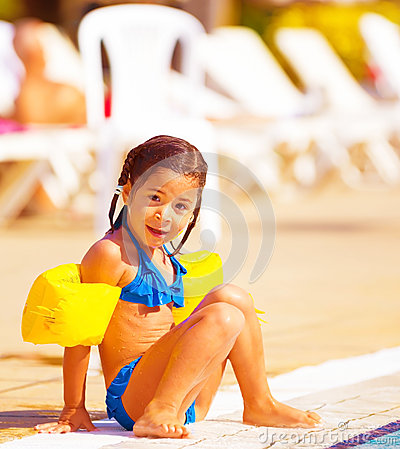 Little girl near pool