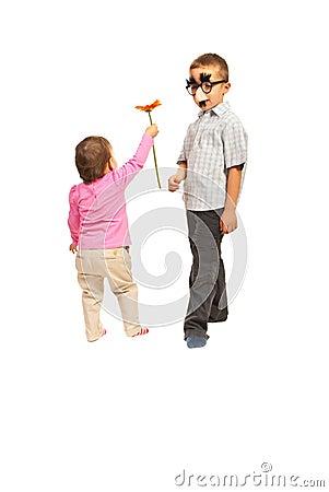 Little girl offer flower to boy