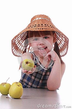 A little girl offers an apple