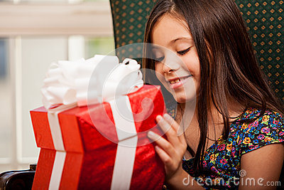 Little girl opening a gift box