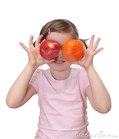 Little girl with orange and apple