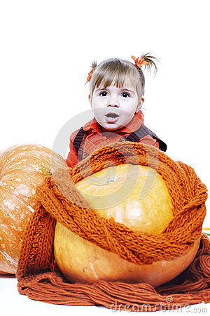 Little girl in an orange vest