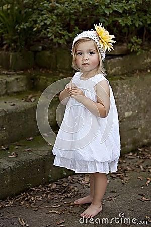 Little Girl Outdoors in Whtie dress