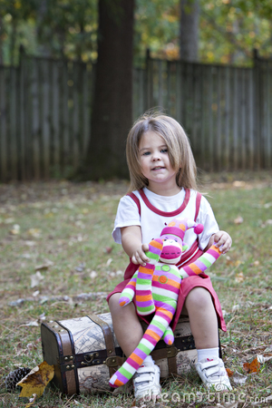 Free Little Girl Outdoors With Toy Monkey Royalty Free Stock Images - 16735359