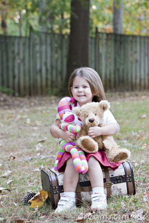 Free Little Girl Outdoors With Toy Monkey And Bear Stock Photography - 16735382