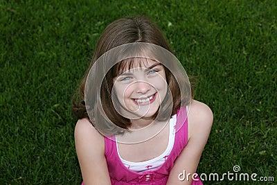 Little girl outside in grass