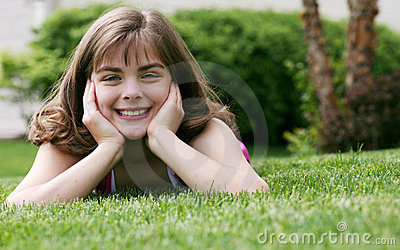 Little girl outside in grass