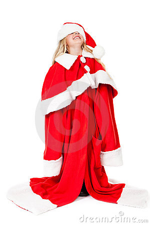 Little girl in a oversized santa costume