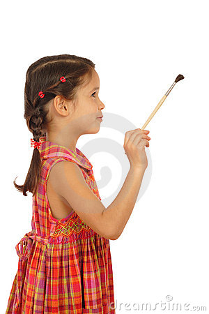 Little girl with a paintbrush, side view
