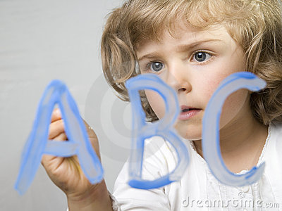 Little girl painting alphabet