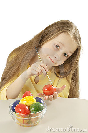little girl painting easter eggs
