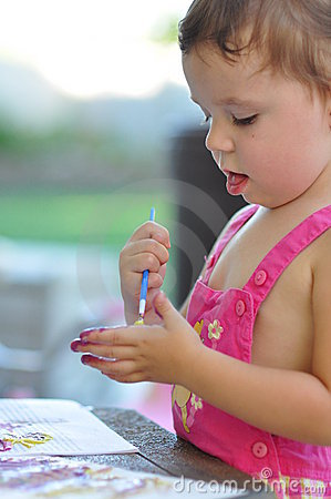 Little girl painting hand