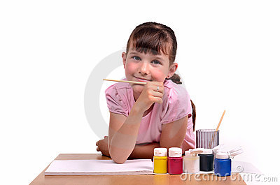 Little girl painting a picture with colorfu paints